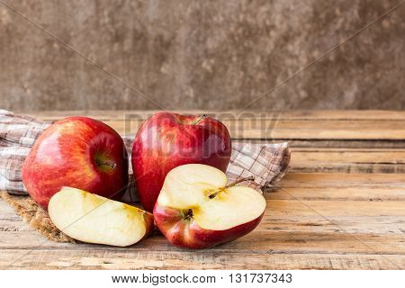 Close up fresh red apple on wooden table