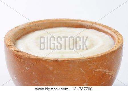 wooden bowl of semolina pudding - detail