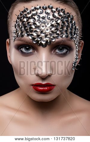 Close-up Portrait Of A Beautiful Girl With Spikes On His Head On A Black Background