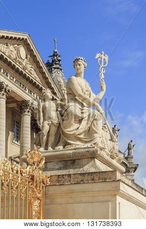 VERSAILLES, FRANCE - MAY 12, 2013: This is one of the sculptures along a fence before the facade of the Palace de Versailles.