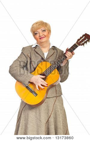 Mature Woman Playing Acoustic Guitar