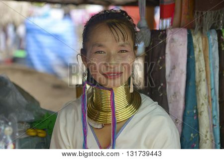 Ayutthaya, Thailand - September - 13 - 2015 Women of the Padaung tribe dressed in ritual costume and typical rings around her neck