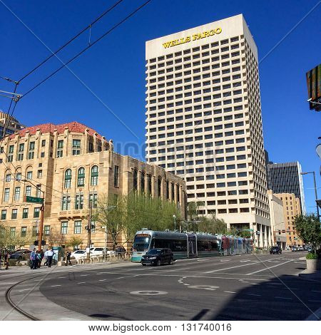 PHOENIX AZ - FEBRUARY 8 2016: Wells Fargo Bank skyscraper rising above historic buildings at 1st Avenue and Jefferson Street in Phoenix Arizona