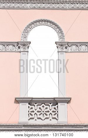 Decorated french door of an Italian neoclassical villa with copy space inside suitable as a frame or border.