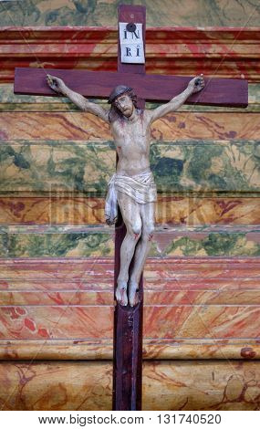 KOTARI, CROATIA - SEPTEMBER 16: Cross on the altar in the church of Saint Leonard of Noblac in Kotari, Croatia on September 16, 2015.