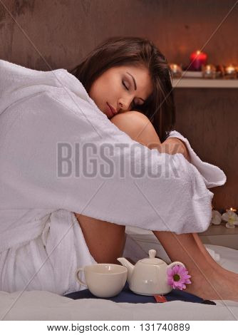 Relaxed woman at beauty center after body treatment spa.