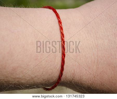 red thread on the hand protection against bad people