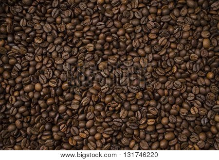 roasted coffee beans coffee background a uniform layer of coffee beans