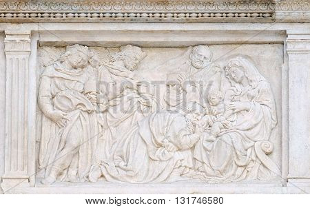BOLOGNA, ITALY - JUNE 04: Nativity Scene, Adoration of the Magi, relief on portal of Saint Petronius Basilica in Bologna, Italy, on June 04, 2015
