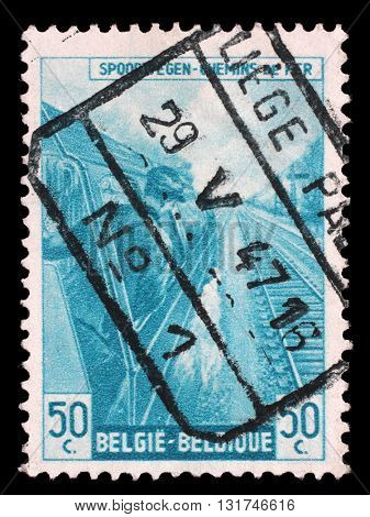 ZAGREB, CROATIA - JULY 03: A stamp printed in Belgium shows Engine driver from The Railway Company at Work issue, circa 1945., on July 03, 2014, Zagreb, Croatia