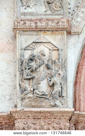 BOLOGNA, ITALY - JUNE 04: Nativity, Birth of Jesus, panel on the left door of San Petronio Basilica in Bologna, Italy, on June 04, 2015