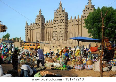 DJENNE, MALI, AFRICA - SEPTEMBER, 5, 2011;  The bustling market of Djenne in Mali early in the morning