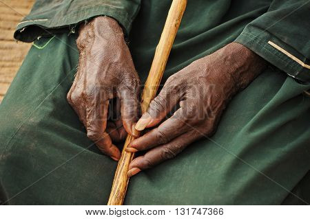 Hands with many wrinkles of old Mali, Africa