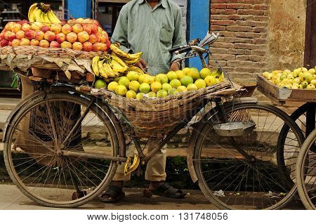 Street selling fruit on a bicycle in India