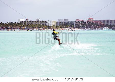 Kite surfer on Palm Beach at Aruba island in the Caribbean