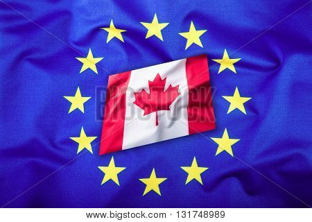Flags of the Canada and the European Union. Canada Flag and EU Flag. Canadian Flag inside stars. World flag concept.