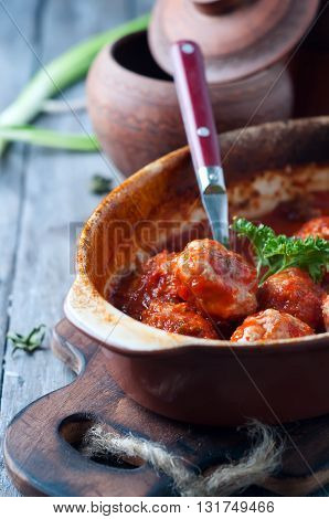 Meatballs in sweet and sour tomato sauce. Top view