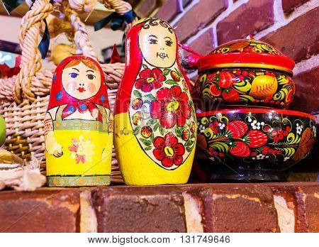 nested dolls and painted wooden utensils including a brick and wooden table