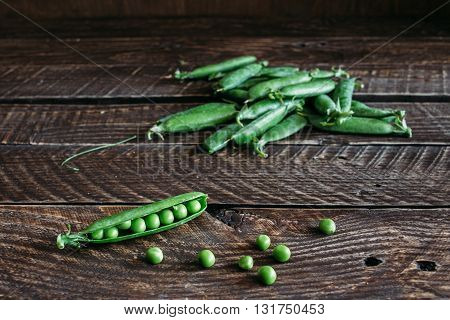 green peas. green peas on a brown background, pods of green peas