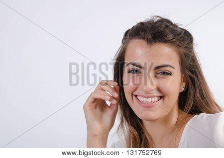 Beautiful blue-eyed woman wearing a white shirt