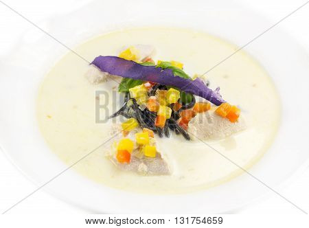Black spaghetti with white sauce with cheese