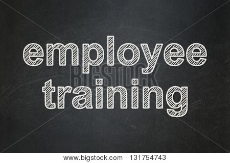 Learning concept: text Employee Training on Black chalkboard background