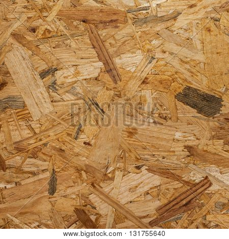 OSB - Pressed wooden panel background seamless texture of oriented strand board