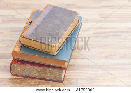 Old Books stack on wooden table background
