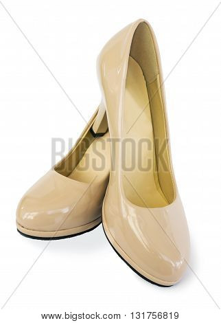 Beautiful shoes of beige color on white background
