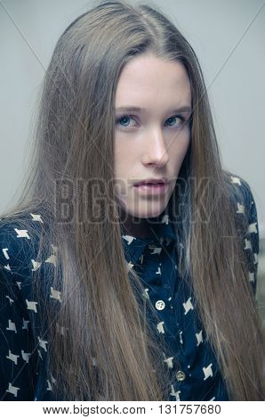 Young Woman Fashion Model with blue shirt portrait