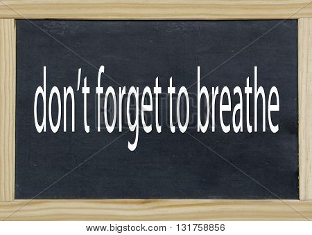 don t forget to breath written on a chalkboard