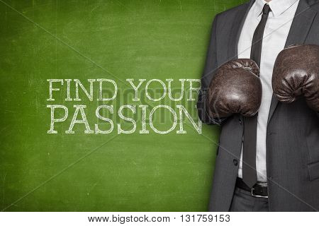 Find your passion on blackboard with businessman wearing boxing gloves