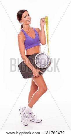 Healthy Brunette Woman Holding A Scale