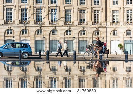 People Riding Bicycles In The Fountain In Bordeaux, France