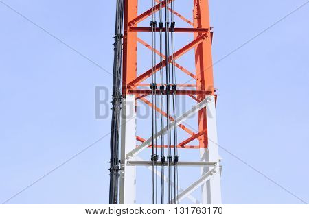 Parts of telecommunication tower with blue sky
