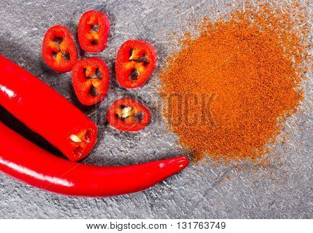 Chili Peppers And Chili Powder On A Black Background