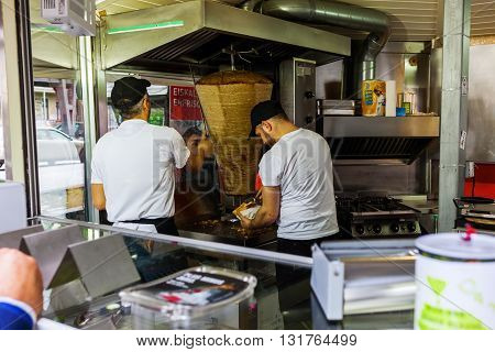 Berlin Germany - May 17 2016: unidentified people in a kebab shop in Berlin-Kreuzberg. Kreuzberg has emerged from one of the poorest quarters to one of Berlins cultural centers