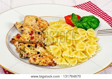 Grilled Chicken Fillet with Pasta Bows Studio Photo