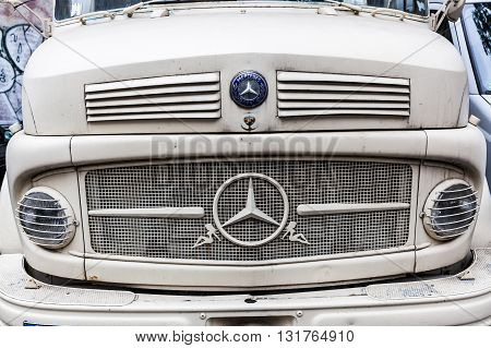 Berlin Germany - May 17 2016: front of a Mercedes Benz truck. Mercedes-Benz is a global automobile manufacturer and a division of the German company Daimler AG.