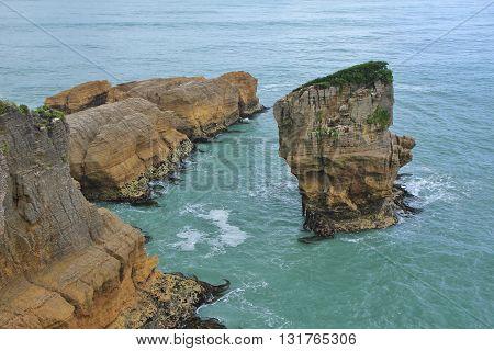 Scene on the west coast of New Zealand. Big rocks in the ocean. Punakaiki.