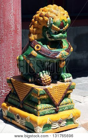 Golden Lion. Buddhist temple. The Tower of Buddhist Incense. Beijing. China.