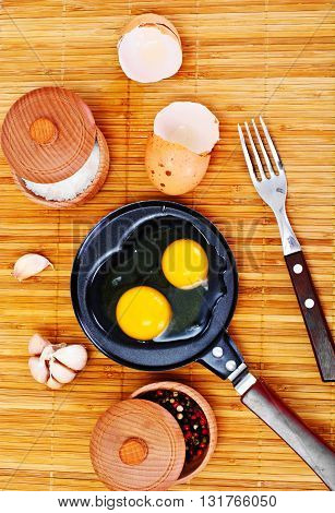 Raw Eggs on Wood Plate Studio Photo