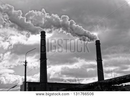 Environmentally harmful industrial chemical production plant polluted air from smokestacks
