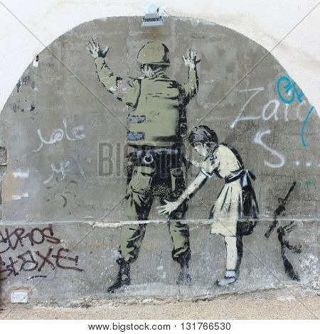 BETHLEHEM, ISRAEL, 2 APRIL 2013. Banksy Graffiti near Separation Wall at the North End of Manger Street