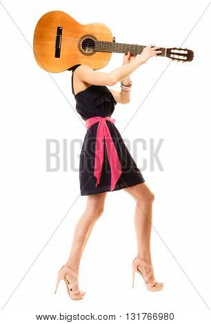 Travel vacation concept. Music lover summer girl in full length holding acoustic guitar isolated on white