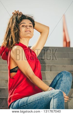 Girl On Stairs In City.