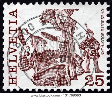 SWITZERLAND - CIRCA 1977: a stamp printed in the Switzerland shows Chesslete Carnival Tradition of Solothurn Folk Customs circa 1977