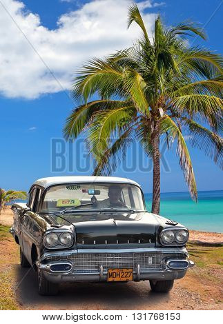 VARADERO, CUBA - MAY, 22, 2013: Black american classic car on the beach