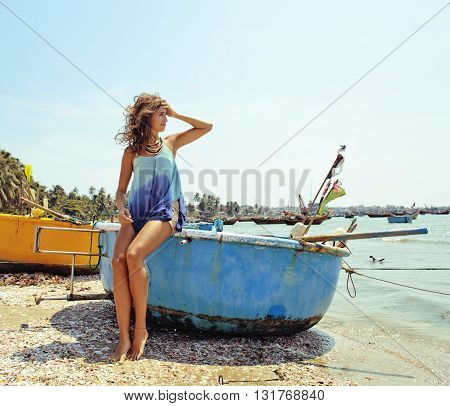 cute smiling young real woman in asian port, vietnam traveller mui ne