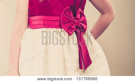 Part body girl wearing beutiful princess fairy dress. Little child in ballerina clothes indoor.